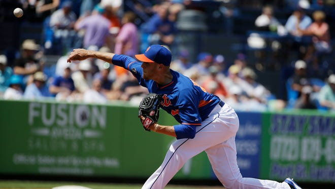 The Mets' Zack Wheeler, seen in earlier exhibition-game action, was roughed up by the National on Tuesday.