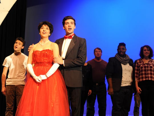 Madeline Carter and Ryan Shreve, along with 28 other cast members, sing during a dress rehearsal Friday evening for White Christmas at Renaissance Theatre.