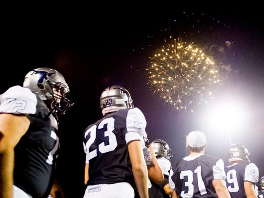 Fireworks go off after winning 56-17 during a game