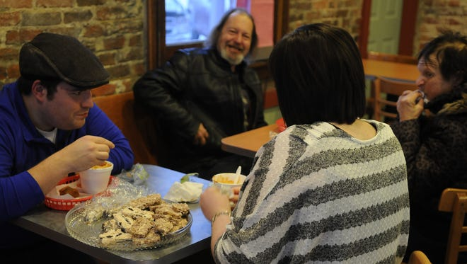 The first free monthly community chili dinner was hosted at The Vault on Thursday night. James Branch, Bill Kronner and Chelsea Branch enjoy the meal together.