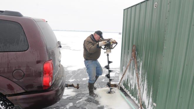 Shanties were moving across Lake Winnebago in preparation for the sturgeon opener on February 14.