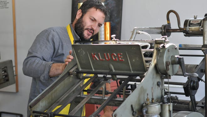 Ryan Howell and his wife Leslie Graham own Rise and Shine Letterpress, a print shop located in a once-abandoned storefront on Lee Street in Alexandria.