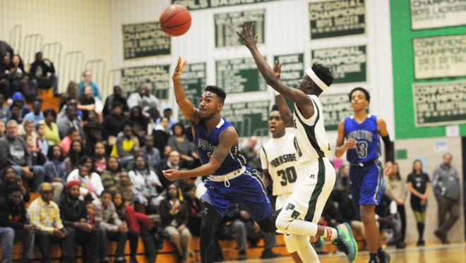 Stephen Decatur's Torrey Brittingham throws an alley-oop to a teammate against Parkside on Thursday in Salisbury.