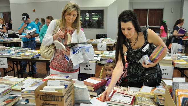 Families shop at the Cenla Christian Homeschool Association book sale held annually in conjunction with the group's kick-off day. The event is scheduled for July 23 this year and will include workshops for both longtime and new homeschool families.