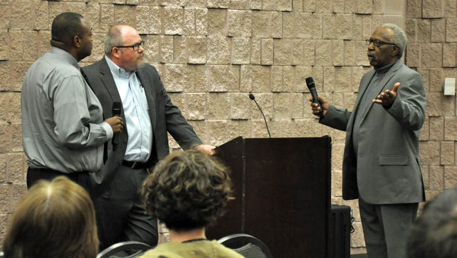 Clarence Benoit Jr., right, describes to Abilene Mayor Anthony Williams, left, and City Manager Robert Hanna the challenges he has had getting city permission to build a carport. Benoit made the comments during the first Mayor's Community Conversation on Monday.