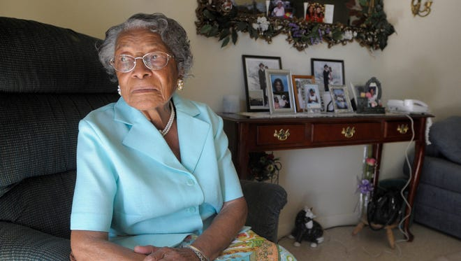 In this Oct. 7, 2010, file photo, Recy Taylor poses for a photo in her home in Winter Haven, Fla. Taylor, a black Alabama woman whose rape by six white men in 1944 drew national attention, died Thursday, Dec. 28, 2017, according to her brother Robert Corbitt. She was 97.