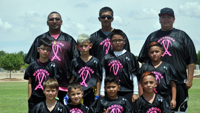 The Carlsbad Warriors flag football team poses following a game on Saturday.