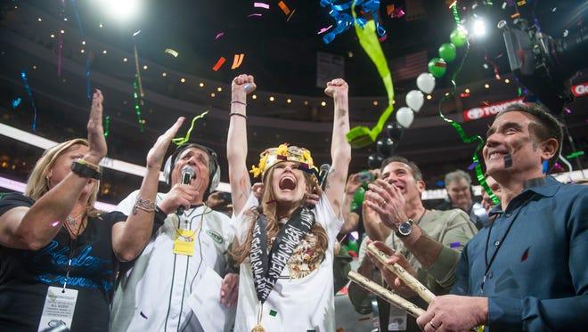 Molly Schuyler, of Bellevue, Nebraska, celebrates after winning Wing Bowl 24 by eating 429 wings at the Wells Fargo Center in Philadelphia.