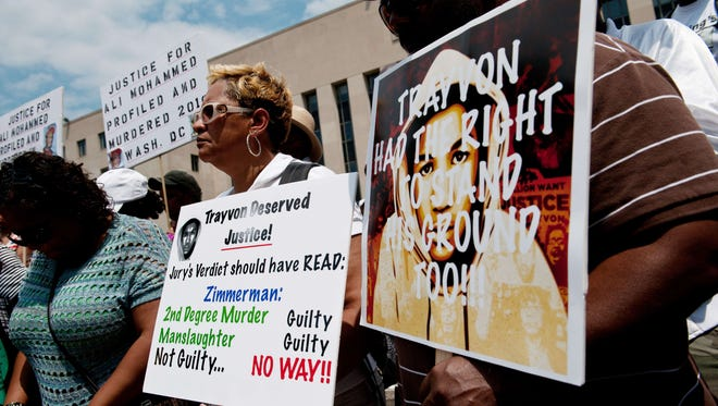 People demonstrate in Washington after the acquittal of George Zimmerman.