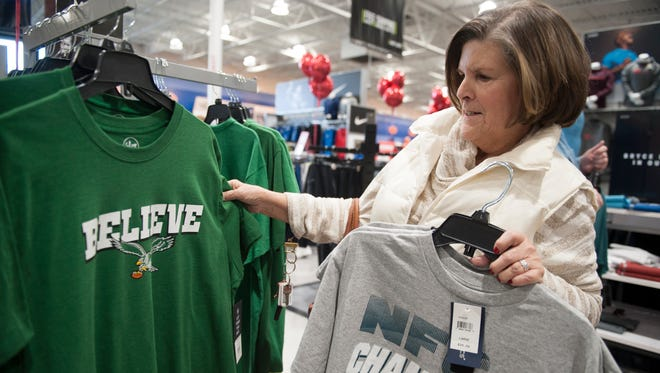 Deborah Ross of Marlton shops for Eagles gear, for her son and grandson living in Michigan, at Dick's Sporting Goods in Mount Laurel on Monday morning after the Eagles won the NFC Championship game Sunday night.
