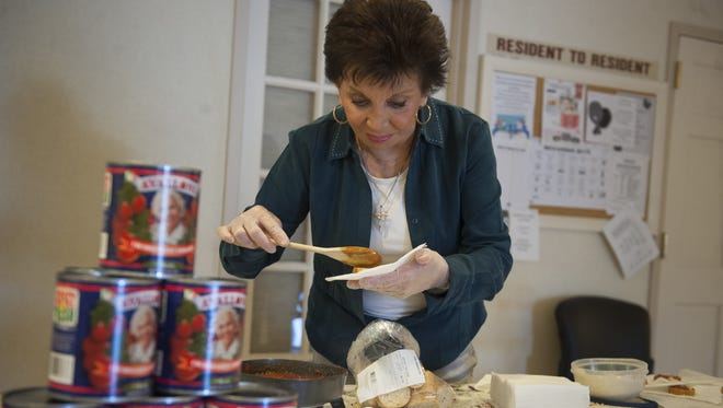 Theresa Belfiore of Cherry Hill, sister of singer Frankie Avalon, serves up samples of marinara sauce made with her Jersey-produced Avallone Tomatoes.