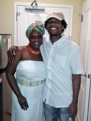 This undated file photo provided by the family of John Crawford III shows him with his mother, Tressa Sherrod.