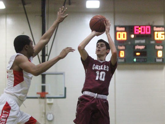 Chiles' AJ Hodges goes up for a jump shot during a