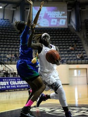 Abilene Christian's Lizzy Dimba (32) goes in for a shot while being defended by Texas A&M Corpus Christi's Ashanti Plummer (22) during the second quarter of the Wildcats' 72-64 win on Wednesday, Feb. 22, 2017, at ACU's Moody Coliseum.
