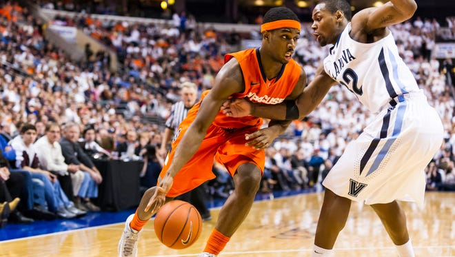 Syracuse forward C.J. Fair is defended by Villanova guard James Bell during last season's game when the Wildcats defeated the Orange 75-71 in overtime.