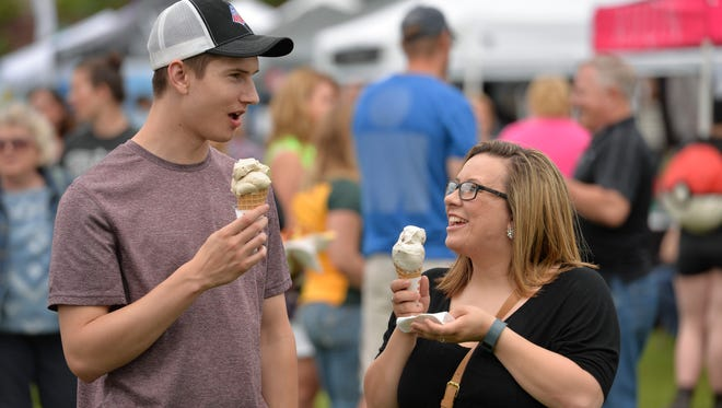 Ben Minkel and Raquel Hoffman of St. Cloud went straight for the ice cream as they and others perused the food offerings at a 2015 Summertime by George! gathering.