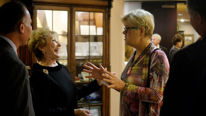 "Texas Business Hall of Fame inductee Dian Stai greets Cynthia Raehl during a Nov. 10 reception in Stai's honor at First Financial Bank. Raehl said Stai was a role model for her and many other women. ""She's an icon,"" Raehl said."