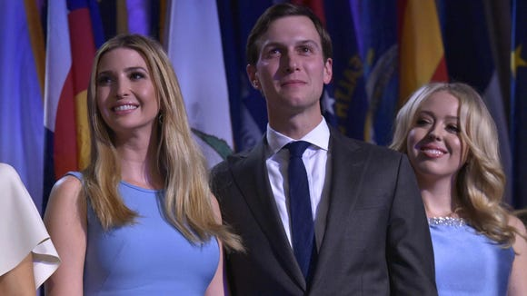 From left, Ivanka Trump, her husband Jared Kushner and Tiffany Trump smile as Republican presidential-elect Donald Trump speaks on Election Night.