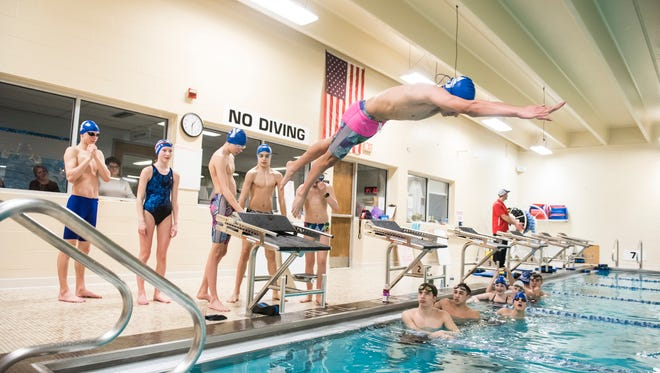 Alan Flores leaps off the starting block during a practice for the Hanover YMCA Stingrays swim team on Feb. 20, 2018. Flores and six of his teammates qualified for the Middle Atlantic Junior Olympics, which will be held at Central York's Graham Aquatic Center next week.