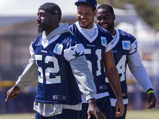 Dallas Cowboys linebackers Justin Durant (52), left,  Kyle Wilber (51), center , Bruce Carter (54), right, talk at NFL football training camp, Thursday, July 31, 2014, in Oxnard, Calif. (AP Photo/Ringo H.W. Chiu)