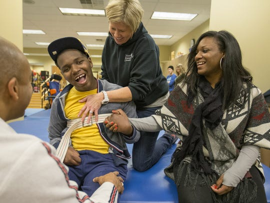 DeAndre Knox sat with his mother, Deandra Yates, as