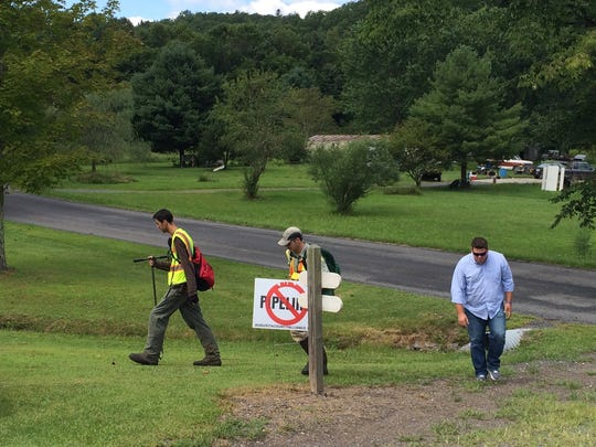 Representatives from Dominion Energy survey a property that the proposed Atlantic Coast Pipeline would run through in Deerfield, Virginia, on August 18, 2016.