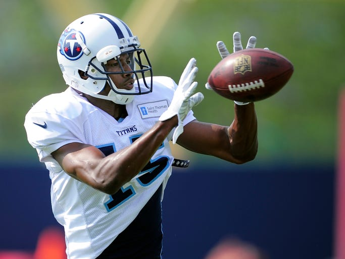 Titans wide receiver Justin Hunter (15) pulls in a pass during practice at St. Thomas Sports Park Wednesday Aug. 6, 2014, in Nashville, Tenn.