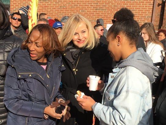 Nashville Mayor Megan Barry, center, speaks with some