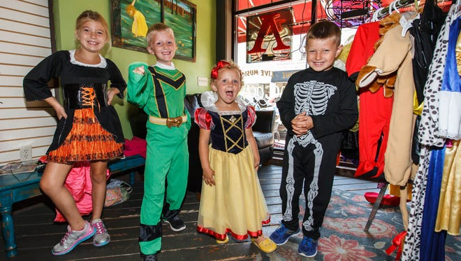 Costume swappers (from left) Marina Sterzinger, Gunnar Peterson, Signe Peterson and CJ Sterzinger show off their costumes during the Oconomowoc Costume Swap in 2015. Roots Coffeebar & Cafe will once again host the swap this year from Oct. 2-6 with costume pick up on Oct. 7.