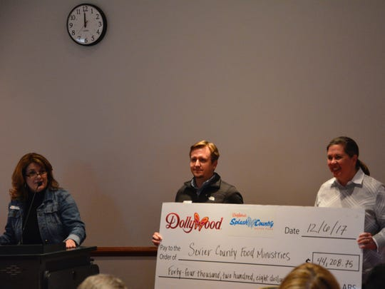 Dollywood presented a check for $44,208.75 to Sevier County Food Ministries on Wednesday, Dec. 6, 2017. From left are Carol Agee, Dollywood community affairs and philanthropy manager; Jason Boothe, Dollywood vice president of operations; and Janet Dawson, general manager of Dollywood's Splash Country.