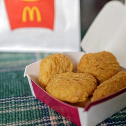 An order of McDonald's Chicken McNuggets. McDonald's says it plans to start using chicken raised without antibiotics important to human medicine and milk from cows that are not treated with the artificial growth hormone rbST.