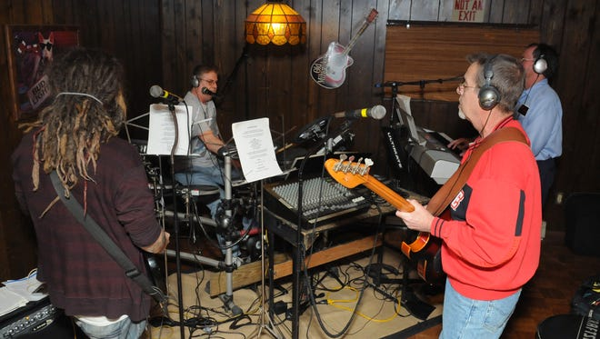 Whiskey River practices Dec. 1 at the home of a band member in Lancaster. Whiskey River performs mostly classic rock mixed with some country and other genres.