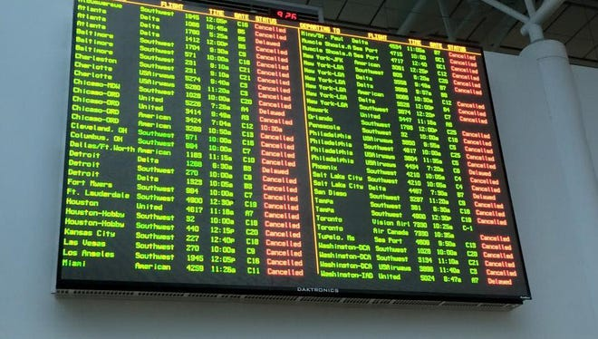 This photo of a Nashville flight display board shows the extent of flight disruptions the morning of Monday, Feb. 16, 2015.