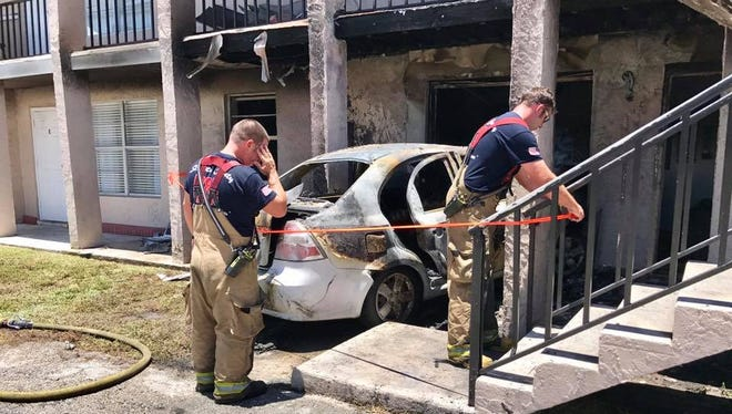 Fire crews work the scene Tuesday, July 4, 2017, after a car ran into an apartment building in the 400 block of Palm Avenue in Fort Pierce.