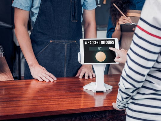 """A point-of-sale device that reads, """"We accept bitcoins."""""""