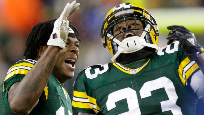 Green Bay Packers cornerback Damarious Randall (23) is congratulated by wide receiver Davante Adams (17) after making an interception during the second quarter of their game Sunday, December 11, 2016 at Lambeau Field in Green Bay, Wis. The Green Bay Packers beat the Seattle Seahawks 38-10.