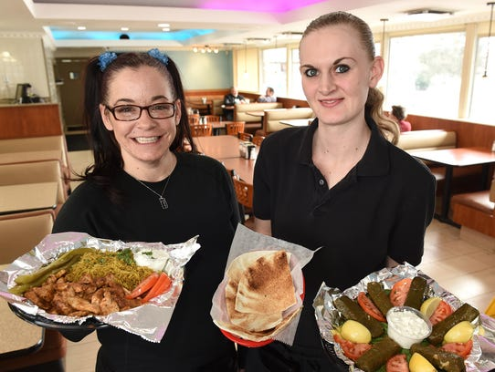 Milford's Pita House waitresses Kristi Nelson, left,