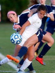 "Siegel's Kirsten Wojciechowski (1) wraps her body around Houston's Abbie Rushwin (2) to kick the ball during a quarterfinal game of the TSSAA Class AAA Girls"" Soccer Tournament, on Wednesday, Oct. 25, 2017, at the Richard Siegel Soccer Complex."