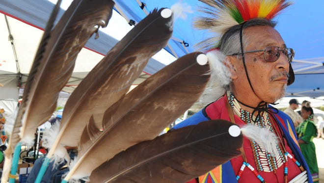 Chuck Cadotte, a Lakota, participates at the Children of Many Colors Native American Powwow at Moorpark College on Saturday.
