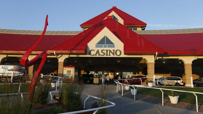 The sun sets Friday, June 26, 2015 at the Prairie Meadows casino and racetrack in Altoona.
