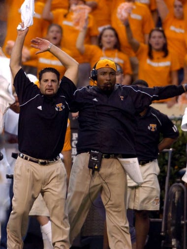 utcal8.MP#6271 MICHAEL PATRICK/NEWS STAFF UT coaches Johnny Long, left, and Trooper Taylor, right, yell instructions to the field during the second half Saturday night in Neyland Stadium. The Vols won the season opener with ease, 35-18.