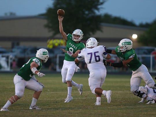 Wall's Mason Fuchs (#9) throws a pass as Mason's Rudy Martinez makes a move toward him during the Friday, Aug. 31, 2018, football game in Wall.