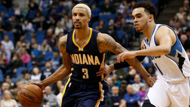 Indiana Pacers guard George Hill (3) drives against Minnesota Timberwolves guard Tyus Jones (1) during the first half of an NBA basketball game in Minneapolis, Saturday, Dec. 26, 2015.
