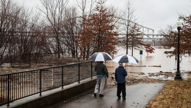 The Ohio River has flooded Water Street near New Albany's Riverfront amphitheater and park Wednesday, Feb. 21. The city is in flood stage as waters continue to rise to near 60 feet.