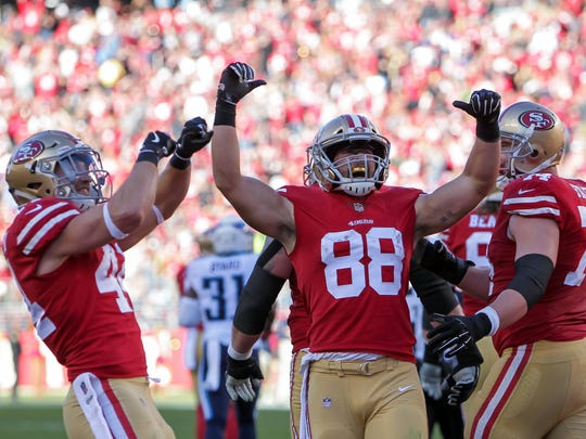 San Francisco 49ers tight end Garrett Celek (88) celebrates after a touchdown during the second quarter against the Tennessee Titans at Levi's Stadium.