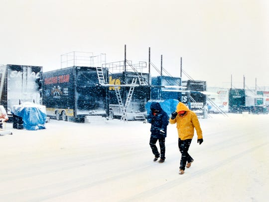 Snow pelts the NASCAR haulers at Atlanta Motor Speedway