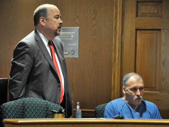 Andrew Sanderson, left, speaks for his client, Kenneth N. Miller, right, during a sentencing hearing Friday in Fairfield County Common Pleas Court in Lancaster. Miller was sentenced to 40 years to life for the murder of Kelly Thompson.
