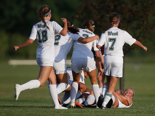 Iowa City West players celebrate after Iowa City West senior Emma Cooper (13) scored the wining goal in overtime against Dowling Catholic Thursday, June 8, 2017, during the 3A girls state quarterfinals at the Cownie Sports Complex in Des Moines.