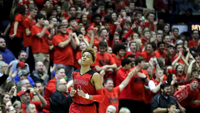 The crowd cheers on New Albany's Romeo Langford after he scored against Seymour in the Class 4A Sectional semifinals. 