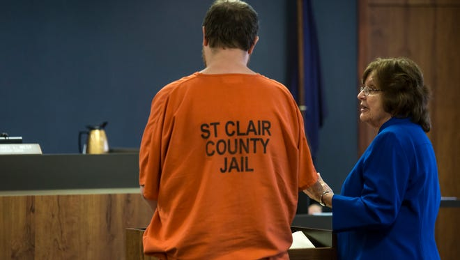 Douglas Ball Jr. speaks to his lawyer, Sharon Parrish, in the courtroom of Judge Michael West during a plea hearing Tuesday, Jan. 3, 2017 at the St. Clair County Courthouse in Port Huron. Douglas Ball Jr. is facing charges of open murder and torture in the August 2016 death of his wife Lydia Ball. Ball was not offered the chance to plea to lesser charges and will proceed to trial on Jan. 12.